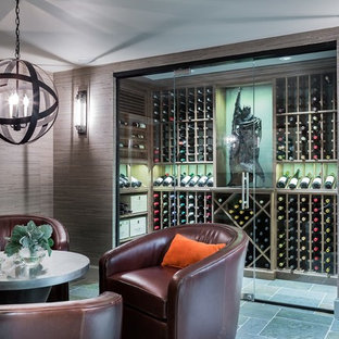 Photo of a medium sized traditional wine cellar in Boston with storage racks and blue floors.