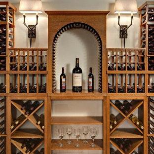 Inspiration pour une grand cave à vin chalet avec un sol en linoléum et des casiers losange.