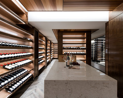 Tropical Wine Cellar In Perth With Light Hardwood Floors, Display Racks And  Beige Floor.