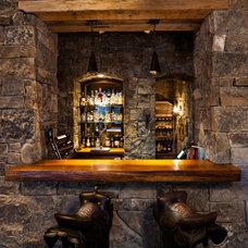 Rustic Wine Cellar by Teton Heritage Builders