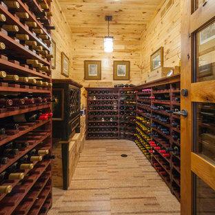 Ejemplo de bodega rústica, extra grande, con botelleros y suelo vinílico