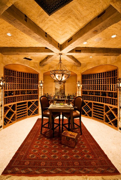 Traditional Wine Cellar by Arc Design Group