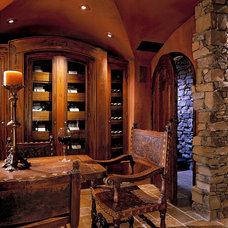 Traditional Wine Cellar by Jones Clayton Construction