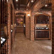 Traditional Wine Cellar by M.J. Whelan Construction