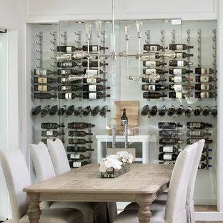 Inspiration pour une cave à vin design de taille moyenne avec un sol en liège, des casiers et un sol beige.