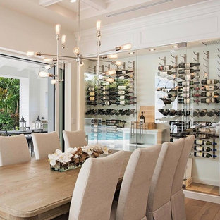 Medium sized contemporary wine cellar in Miami with cork flooring, storage racks and beige floors.