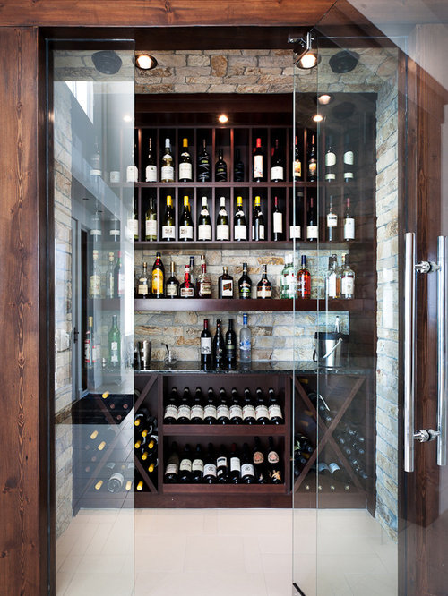 Charming Walk In Wine Cellar #1: Contemporary White Floor Wine Cellar Idea In Vancouver With Display Racks