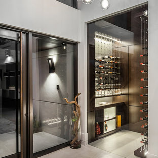 Inspiration for a large contemporary concrete floor and gray floor wine cellar remodel in Miami with storage racks