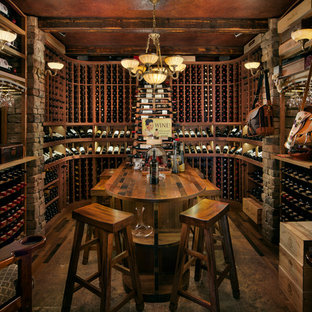 Inspiration for a mid-sized rustic concrete floor and brown floor wine cellar remodel in Phoenix with storage racks