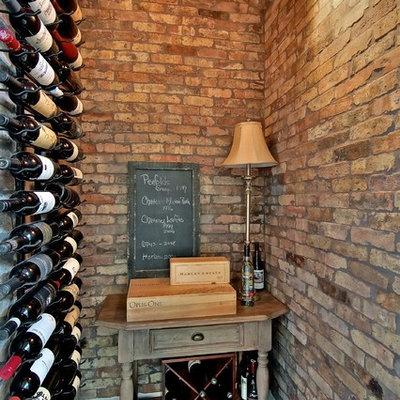 Wine cellar - traditional dark wood floor and red floor wine cellar idea in Austin with display racks