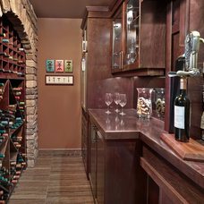 Traditional Wine Cellar by Kimberley Homes