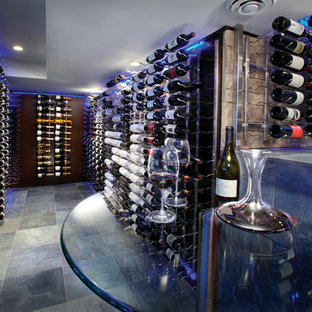 Inspiration for a large contemporary wine cellar in Other with ceramic flooring, storage racks and blue floors.