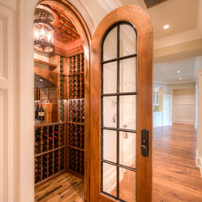 Traditional Wine Cellar by Solaris Inc.