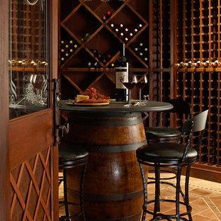 Inspiration för en vintage vinkällare, med vinställ med diagonal vinförvaring och orange golv