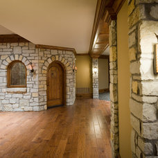 Traditional Wine Cellar by Carrington Homes