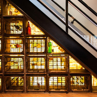 Wine cellar - small industrial wine cellar idea in Vancouver with storage racks