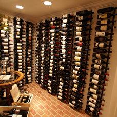 Traditional Wine Cellar by Matthew Bowe Design Build, LLC