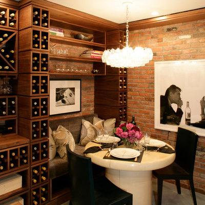 Example of a transitional wine cellar design in New York with storage racks