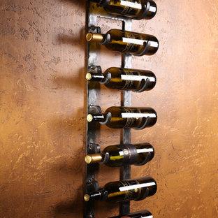 Inspiration för en mellanstor vintage vinkällare, med travertin golv, vinhyllor och flerfärgat golv