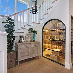 Inspiration for a beach style medium tone wood floor and yellow floor wine cellar remodel in & 75 Wine Cellar Design Ideas - Stylish Wine Cellar Remodeling ...