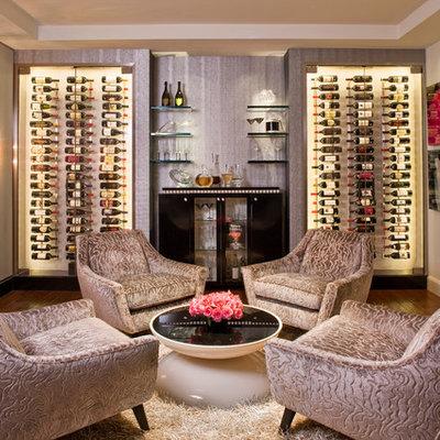 Large trendy dark wood floor and brown floor wine cellar photo in Los Angeles with storage racks