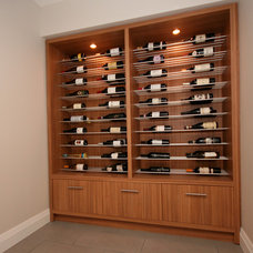 Contemporary Wine Cellar by oomph design inc.