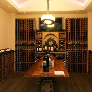 Réalisation d'une cave à vin tradition avec un présentoir.