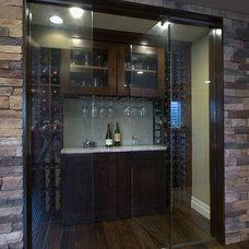 Contemporary Wine Cellar by Aspen Builders