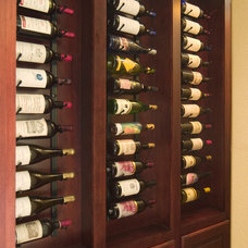 Traditional Wine Cellar by Silver Sea Homes