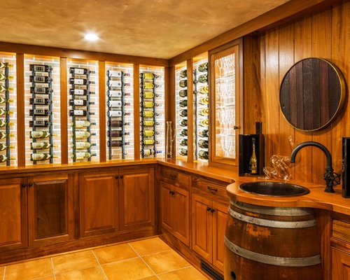 Inspiration for a mid-sized timeless wine cellar remodel in Other with ...