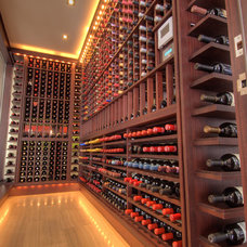 contemporary wine cellar by London Audio Ltd
