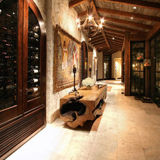 Mediterranean Wine Cellar by Zbranek & Holt Custom Homes