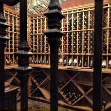 Mediterranean Wine Cellar by Zbranek & Holt Custom Homes