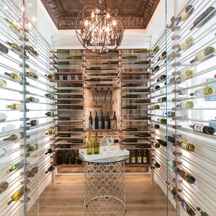 Photo of a contemporary wine cellar in Los Angeles with medium hardwood flooring, storage racks and brown floors.