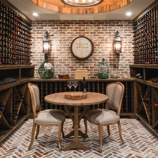 Design ideas for a traditional wine cellar in Atlanta with brick flooring and storage racks.