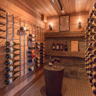 Photo of a medium sized classic wine cellar in Boston with storage racks.