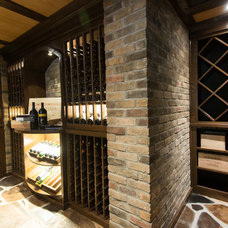 Traditional Wine Cellar by The Original Creative Spaces