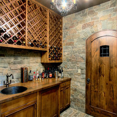 Traditional Wine Cellar by Hilary Young Design Associates