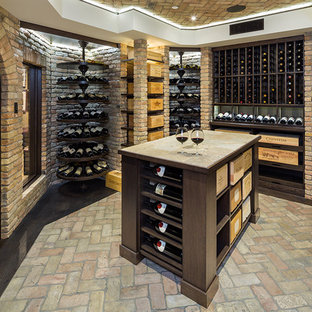 This is an example of an expansive rustic wine cellar in Other with brick flooring, display racks and multi-coloured floors.