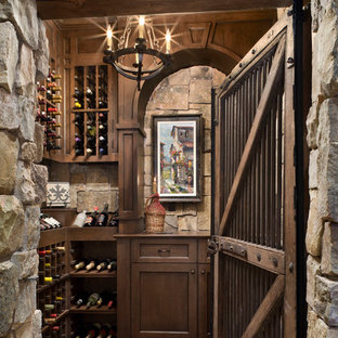 Example of a mountain style wine cellar design in Other with storage racks