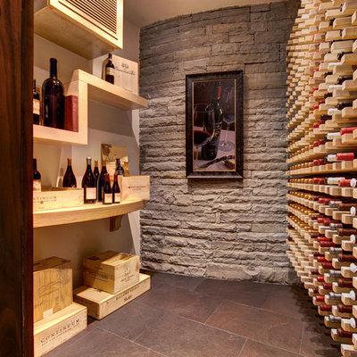 Wine cellar - contemporary wine cellar idea in Atlanta with storage racks