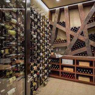 Example of a trendy beige floor wine cellar design in Orange County with display racks