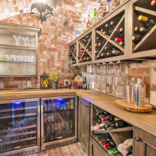 Wine cellar - rustic brick floor and red floor wine cellar idea in San Francisco with diamond bins
