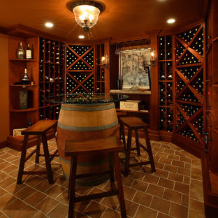 Inspiration for a timeless brown floor wine cellar remodel in New York with diamond bins