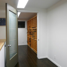 Midcentury Wine Cellar by Klopf Architecture