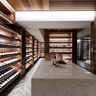 Inspiration for an expansive contemporary wine cellar in Gold Coast - Tweed with display racks.