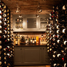 Traditional Wine Cellar by Darci Goodman Design