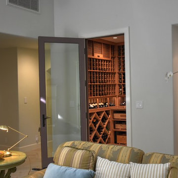 Laguna Hills Orange Small County Custom Wine Cellar with Wrought Iron Door