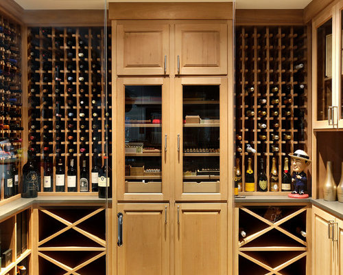 Example Of A Transitional Wine Cellar Design In Chicago With Storage Racks