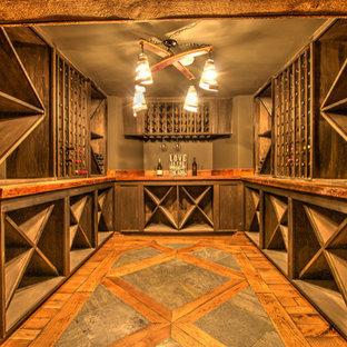 Foto de bodega clásica, grande, con suelo de madera en tonos medios, botelleros de rombos y suelo multicolor